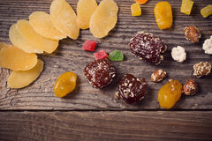 Nuts and dried fruits on wooden background Stock Photo