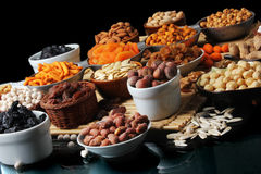 Nuts family on dark background Royalty Free Stock Photo