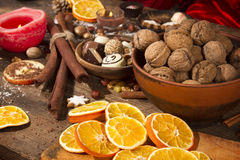 Nuts and festive decoration. On a rustic wooden table Stock Photography