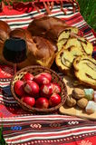 Nuts filling pound cake and red eggs for Easter Royalty Free Stock Image