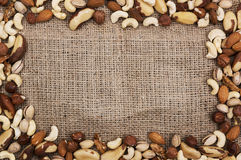 Nuts in the frame shape on sackcloth Stock Photo