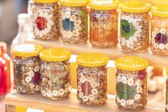 Nuts and fruit in glass jars. Canned superfood Stock Photography