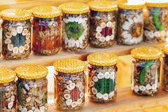 Nuts and fruit in glass jars Stock Photography