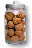 Nuts in glass jar w/ clipping Stock Images