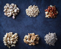 Nuts on grunge background flat lay. Royalty Free Stock Image