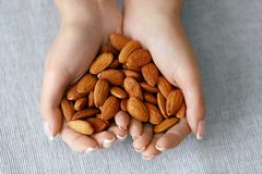 Nuts In Hands. Woman Hands Holding Healthy Food. Female Holding Healthy Snack. Nutrition And Diet Concept. High Quality Image stock images