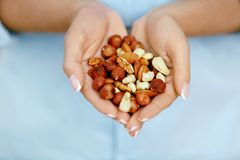 Nuts In Hands. Woman Hands Holding Healthy Food royalty free stock image