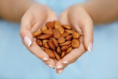 Nuts In Hands. Woman Hands Holding Healthy Food royalty free stock images