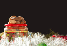 Nuts heaped in a Christmas-themed plastic containe Stock Photography