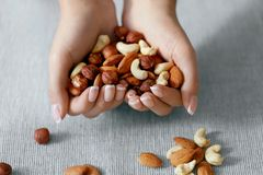 Nuts Heart. Hands Holding Different Nuts. Close Up Of Woman Holding Healthy Food, Snack In Heart Shaped Hands. Healthy Nutrition And Diet. High Quality stock photos