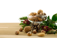 Nuts,holly and pine cone Stock Photo