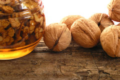 Nuts in honey Stock Images