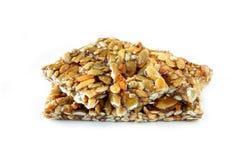 Nuts and honey bar Stock Photos