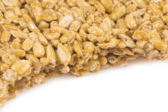 Nuts-and-honey bar on white royalty free stock images