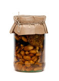 Nuts, honey and fig in the jar Stock Photos