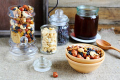 Nuts and honey in jars Royalty Free Stock Photo