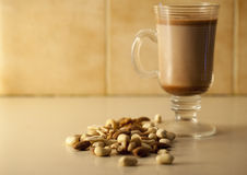 Nuts and Hot Chocolate. Mixed assortment of nuts and a glass of hot chocolate Stock Images