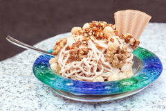Nuts with ice-cream and cream Stock Photos