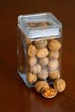 Nuts jar - walnut stock photos