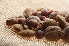 Nuts. On the jute background royalty free stock photos