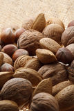Nuts. On the jute background royalty free stock images