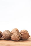 Nuts on the kitchen wooden board Stock Photos