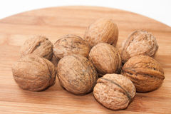 Nuts on the kitchen wooden board Royalty Free Stock Photography