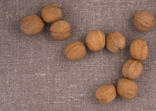Nuts on linen background Royalty Free Stock Photos