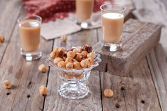 Nuts with liqueur. Nuts with sweet liqueur, selective focus Stock Image