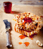 Nuts,maple syrup and honey caramel tart Stock Image