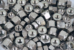 Nuts - metal and tools. Metal Nuts - tools and parts Stock Photo
