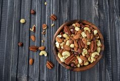 Nuts mix in a wooden plate stock photo