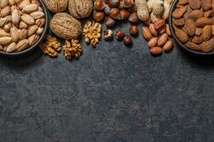 Nuts mix dried fruits, different kind of nut. Healthy food on wooden table. Walnut, hazelnut, pistachio, peanut, almond. Assorted nuts concept royalty free stock photo