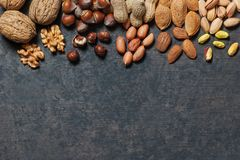 Nuts mix dried fruits, different kind of nut. Healthy food on wooden table. Walnut, hazelnut, pistachio, peanut, almond. Assorted nuts concept stock photography