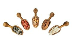 Nuts mix dried fruits in wooden shovel. Or spoon, different kind of nut, healthy food on wooden table. sunflower seeds,pumpkin seeds, pistachio, peanut, almond stock images