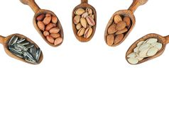 Nuts mix dried fruits in wooden shovel. Or spoon, different kind of nut, healthy food on wooden table. sunflower seeds,pumpkin seeds, pistachio, peanut, almond stock photos