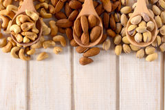 Nuts mix in ladles Stock Photography