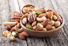 Nuts mix. In a wooden plate Royalty Free Stock Image