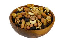 Nuts mix in a wooden plate isolated on white background. Nuts mix in a wooden plate Royalty Free Stock Images