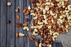 Nuts mix in a wooden plate stock photos