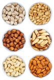 Nuts nut collection from above hazelnuts portrait format bowl is. Olated on a white background Stock Images