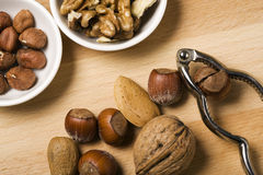 Nuts with Nutcracker Stock Image