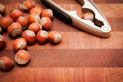 Nuts and nutcracker. On wooden background Stock Photography