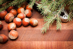 Nuts and nutcracker. On wooden background with Christmas tree stock photos