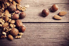nuts on old wooden background Royalty Free Stock Images
