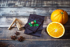Nuts, orange, chocolate and different spices Royalty Free Stock Photos