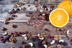 Nuts, orange, chocolate and different spices Stock Images