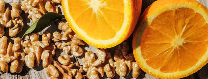 Nuts and orange Stock Images