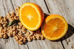 Nuts and orange Stock Photo
