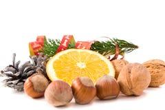 Nuts and orange xmas decoration Royalty Free Stock Images